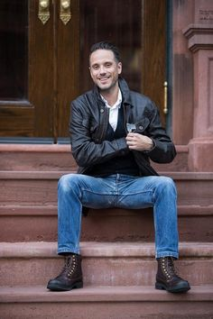 Style Guide - He Spoke Style Jeans, brown lace-up boots, dark leather jacket, white collared shirt and cardigan vest.
