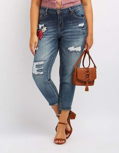 Plus Size Dollhouse Patch Destroyed Skinny Jeans  These mid-rise, dark wash jeans mix heavy shredding and ripping with a little fabulous fading for a trendy, destroyed finish on these trendy skinny jeans! But that's not all -- rose patches add a little charm, while step hems offer that fabulous frayed look! Zip fly with top button Five pocket cut Brands We Love: Dollhouse Product