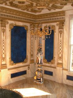 Beaux-Arts Neo Classical wall panels with cobalt blue venetian plaster, faux marble, ornamentation for pilasters.