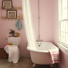 Pretty pink walls give any bathroom a serene feel -- but huge windows, a potted plant and freestanding clawfooted vintage bathtub make this one especially charming. Find your perfect pink paint color here on our Style Guide! Pink Paint Colors, Room Colors, Flat Interior, Interior Exterior, Tub Paint, Murs Roses, Pink Tub, Design Industrial, Best Bath