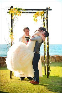Cute huge wedding hug from the bride. Captured By: Stephen Ludwig ---> http://www.weddingchicks.com/2014/06/09/ohana-wedding-in-honolulu/