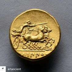 """The reverse of an ancient Greek gold stater, struck in the name of the brilliant King Philip II of Macedon. Issued by the Pella mint, circa 340 BC. Showing Philip II racing a two horse chariot. The horses rearing and snarling as Philip leans forwards, gripping the reins in one hand and raising his goad with the other, his cloak billowing in the rushing wind. The Greek legend below reads, """"Of Philip"""""""