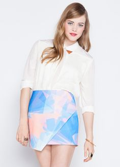 """Geo print skirt in your favorite pastels. Features side zipper closure.     100% polyester  13"""" length  Model is wearing size S"""