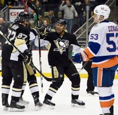 The Penguins' Sidney Crosby and Trevor Daley celebrate with Brian Dumoulin after his shot was redirected by Chris Kunitz to beat Islanders goaltender Jean-Francois Berube in the first period Tuesday, March 15, 2016, at Consol Energy Center. — Chaz Palla | Tribune-Review