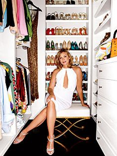 Kim Cattrall's 44-square-foot closet with its double-hung racks and endless shelves of shoes and purses.