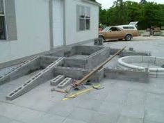 idea for ramp build cement pour; want cement deck at door level across front of federal style . Handicap Accessible Home, Handicap Ramps, Entry Stairs, Deck Stairs, Federal Style House, Ramp Design, Deck Building Plans, Small Porches, Front Porches