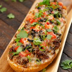 This taco pizza bread recipe is everything you love about both of your favorite foods, united into one awesome(ly) easy to pull off hybrid. Classic taco toppings like Taco Pizza, Making Homemade Pizza, Homemade Tacos, Fusion Food, Mexican Dishes, Mexican Food Recipes, Italian Recipes, French Bread Pizza, Refried Beans
