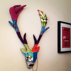 i made this colourful stag head with a little moustache on his nose and a characterful monocle on his face :)