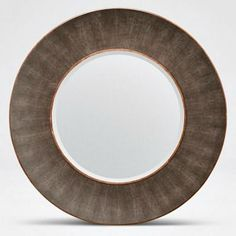 The wide frame and concave circular shape of the Armond Wall Mirror from Made Goods brings out the impressive pattern of its mushroom faux shagreen finish. The sycamore and walnut trim tastefully highlight the sophisticated material, making this home accessory a eye-catching statement piece. Imagine this stunning piece in your entry, dining room or master bedroom!