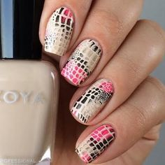 Exotic snake skin design for the nails are created using the stamping technique. Recreate this nail art with the nail products used here.