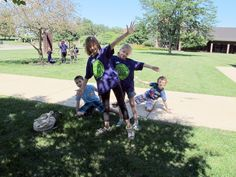 Grade school kids showcase a team cheer they created during the language art portion of the Green Team Building Sustainability class, part of the MCC Tech Camp program at McHenry County College. Their instructor is Beth Gola.