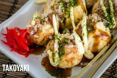 Takoyaki is a popular street food from Osaka with bits of octopus and dough inside a slightly crispy shell, garnished with takoyaki sauce, mayo, and Aonori.
