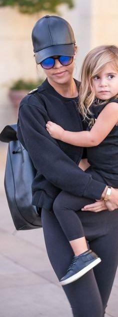 Kourtney Kardashian: Hat – Neil Barrett  Jacket – Calvin Klein  Shoes – Yeezy  Sunglasses – Spitfire Teddyboy