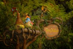 This is the sign in front of Pixie Hollow at Disneyland. Attraction World, Park Signage, Pixie Hollow, Disney Fairies, Museum Exhibition, Magic Kingdom, Walt Disney, Disneyland, Christmas Ornaments