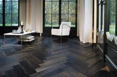 Plywood arranged herringbone stained walnut for floors