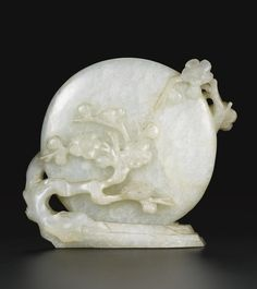 A PALE CELADON JADE CARVING OF THE MOON QING DYNASTY, 18TH CENTURY carved in the form of a full moon