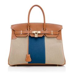The handbag of all handbags, the Hermes Birkin is a quintessential accessory radiating of true French luxury and style. Named after actress Jane Birkin, it remains a highly-coveted piece due to immaculate craftsmanship and a timeless design. This limited edition 35cm Birkin Flag is made from blue and beige Toile with natural Barenia leather details and Permabrass hardware. Stamped [ R ]. Made in 2014.
