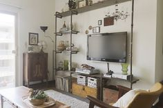 Love this pipe shelving unit!