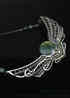 Winged sun necklace