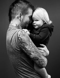 This is my daughter Hayden and myself photographed for a Canadian Family magazine article about dads with their children's names tattooed on them.    Story behind the tattoo: Hayden was born during a blue moon so there is one behind her name and above it is a rose with a pink diamond inside it for my little girl.  Here is the link to the article:  http://www.canadianfamily.ca/articles/slideshow/dad-behind-ink/