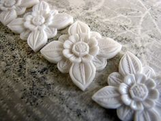 Abadi Carved Bone Balinese Architectural Flower Cabochon by Indounik, $9.00 There's also a drilled version for pendants in a separate listing in my Etsy shop. #Bali #jewelrysupplies