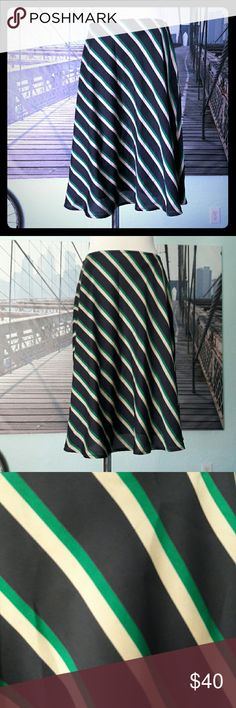 "ANN TAYLOR striped A-line swing skirt, sz 2 Swinging striped A-line skirt by ANN TAYLOR with a silky feel and appearance. Navy base with kelly green and beige stripes, appropriate for work, church, and fun. Fully lined, side zip. Positively NO flaws. Sz 2, runs more like a sz 4, though; appr. measurements: 14.5"" across waist, 22.5 long. Hips open. Ships from a smoke-free, expertly dog-supervised home. :-) Fast shipper, top-rated seller & Posh Ambassador! :-) Ann Taylor Skirts A-Line or Full"