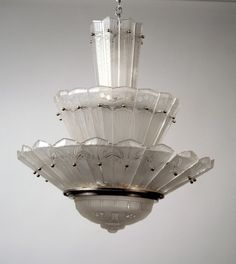 A multi-layer~Frosted~Molded glass chandelier~By Ernest Sabino~In a metal frame~Made in France~Circa 1930