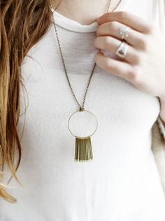 This circle matchstick necklace goes with EVERYTHING, and you can make it yourself! Click for this frugal DIY jewelry tutorial!