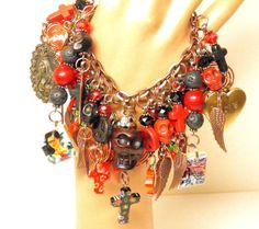 One of a Kind Artisan Handcrafted Day of the Dead Super Chunky Loaded Charm Bracelet with Black and Red Turquoise Sugar Skulls, Handmade Lampwork Glass Beads, Swarovski Crystals, Vintage Brass Locket, and Frida Kahlo & Virgin of Guadalupe Charms, on a Copper Chain Bracelet with an Ornate Copper Leaf Toggle. #8 in My New Limited Edition Frida Kahlo Day of the Dead 2013 Series. Handcrafted by MelancholyMind on Etsy