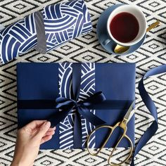 Looking Luxurious Matt Indigo wrapping paper topped with our Matt Weave in Indigo.