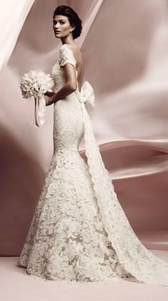 I sketched my dream wedding dress years ago, and it looked just like this. Except with lace long sleeves. Love fit & flare