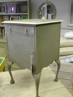 A charming bedside cabinet/side table painted French Linen (Annie Sloan) and available at Painted Country.