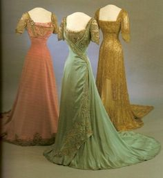 "The dress in the center is the one Maud wore for the pic taken in 1909. The dress was made by Lafferrière, composed of ice green silk satin, it is embroidered in green and silver. The dress is 'shaped like a pinafore over a blouse of metal lace, and the right front drapes asymetrically over the left'.  (From the book ""Style and Splendour: The wardrobe of Queen Maud of Norway"")"