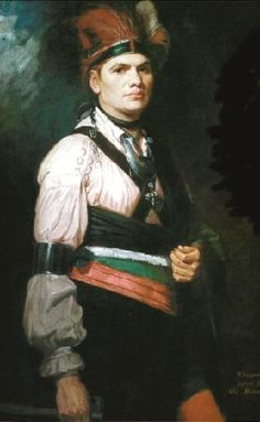 Thayeadanegea, Joseph Brant, the Mohawk Chief, by George Romney, ca.   1776. A chain of  ring brooches that seemingly trifurcates at the shoulder apparently descends from  the upper rim  of his  ear, while other brooches are fastened to  his leather shoulder belts  and blanket. A crescent gorget, an ornate crucifix and  a broad armband complete his outfit.  [Trade Ornament usage among the native peoples of Canada 1992 page 76 Karlis Karklins]