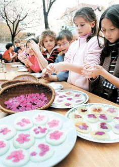 Making hwajeon (화전), Korean rice cakes with edible flowers.