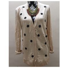 """Sequin polka dot cardigan condition: excellent, worn 1-2x retail: $39 details: - cream cardigan with black sequin polka dots on front - button down - cotton, nylon, viscose - up to 44"""" inch bust, 30"""" length   offers welcome-please use offer link! bundle to save the most.  no trades. ask ?s. happy poshing! Old Navy Sweaters Cardigans"""
