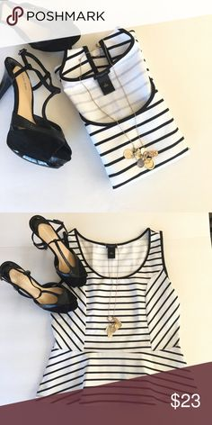 """Ann Taylor top Black and white striped sleeveless peplum top. This peplum cuts a sleek and feminine silhouette. Pair with black cropped pants. Size M, 23"""" long. Like new condition.    🚫 No Trades 💯% Authentic  💵 Offers welcome 💰Bundled discount 📦 Ships in 1-2 days Ann Taylor Tops Tank Tops"""