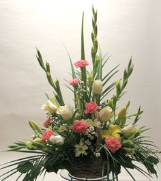 carnation and gladiolus floral arrangements | Basket / Container Arrange