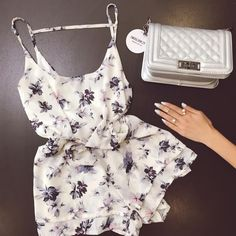 Our Floral white Romper paired with our Silver chain purse! http://modlook29.com/collections/dresses