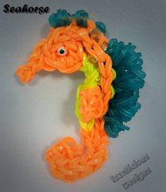 SEAHORSE Charm. Designed and loomed by Kate Schultz on the Rainbow Loom. (Rainbow Loom FB page) I must get pattern!
