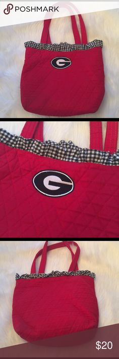 """⭐Purse⭐ ⭐Quilted UGA bag⭐In good condition⭐Minimal signs of wear, most notable at bottom of the bag⭐No rips or tears in the interior or exterior⭐Interior is clean⭐One interior zip pocket⭐Approximate measurements lying flat are: Height 9 1/2"""", Width 12 1/2"""", Length 4"""" & Strap drop 8 1/2""""⭐Please use the offer button⭐I WILL NOT respond to offers in the comments⭐🚫NO TRADES🚫 Bags Shoulder Bags"""