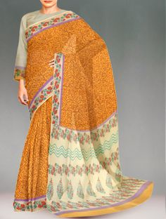 Shop online designer pure rajasthani kota cotton saree at unnatisilks.com Yellow and cream color pure handloom Rajasthani kota cotton saree with matching blouse.This cotton sari has got all over brown mango booti block prints along with orange,green floral block printed cream border on either side.And it has block printed elegant pallu.It is suitable for casual and corporate wear. To purchase online Kota cotton sarees please visit our site http://www.unnatisilks.com/