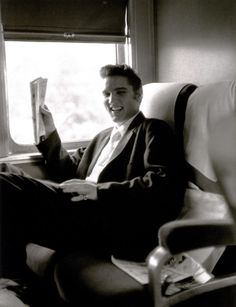 GOING HOME by Alfred Wertheimer.: Elvis travels by train from New York to Memphis, TN, to perform at Russwood Park for the July 4, 1956 benefit show.