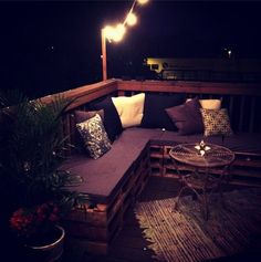 Night view of my DIY pallet couch from the balcony.   Pallets - $0 Foam - $40 from Craig's List Fabric - $15 from Wal Mart  Pillows - $75 from Target