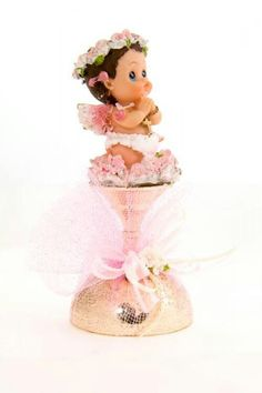 Baptism party favors made up of a baby angel figurine on top of a gold cup wrapped in pink tulle. Baptism Party Favors, Baptism Centerpieces, Diy Centerpieces, Decorations, Baby Baptism, Christening, Baptism Ideas, Royal Party, First Holy Communion