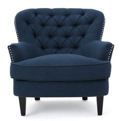 Accent your parlor ensemble with this tufted arm chair, or use it to keep folded towels and linens on-hand in the guest suite.