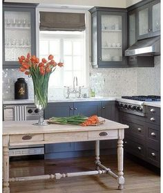 Designer Kitchens - I like the dark gray/black against the white. Glass doors on top give it a light look.