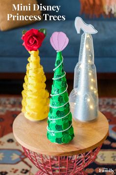Help make the season bright with a little inspiration from some of your favorite princesses! With dazzling designs themed to Ariel, Belle, and Cinderella, these Mini Disney Princess Trees will bring extra magic to your little one's room this season. Disney Christmas Crafts, Disney Christmas Decorations, Disney Home Decor, Disney Crafts, Diy Christmas Ornaments, Christmas Time, Disney Christmas Village, Modern Christmas, Christmas Cross