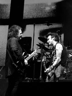 Robert Smith and Simon Gallup of The Cure