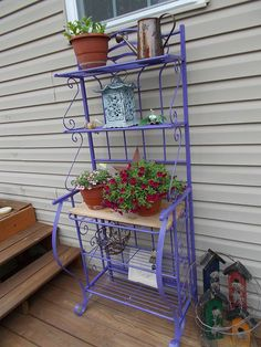 I can't help it, I bought one can of spray paint to paint the bakers rack, and it snowballed from there.....the white plastic chairs are now aqua, the rusted ob…